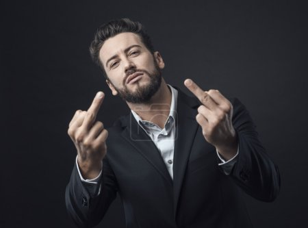 Photo for Cool handsome angry man showing off middle fingers - Royalty Free Image