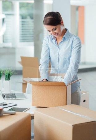 Business woman unpacking