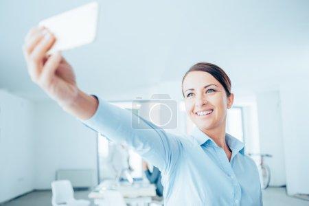 Smiling woman taking a selfie
