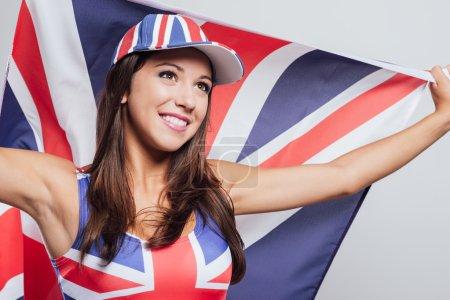 Cheerful English girl with a flag
