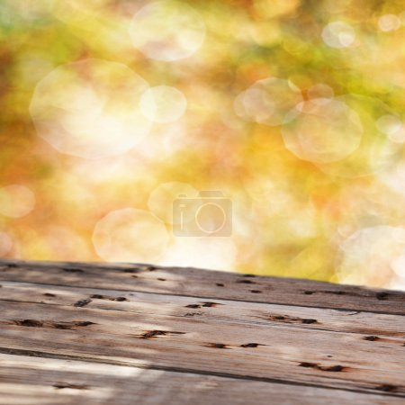 Photo for Empty table for product display montages on golden blurred background - Royalty Free Image