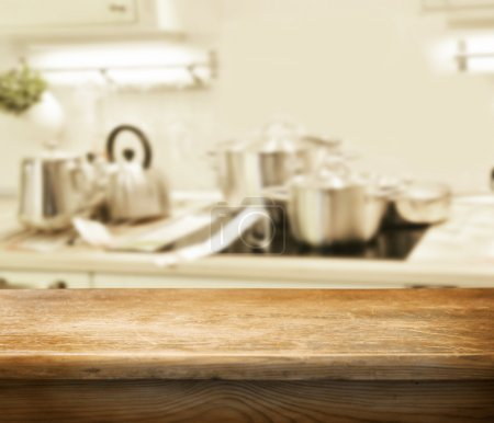 Photo for Empty table for product display montages on the kitchen background - Royalty Free Image