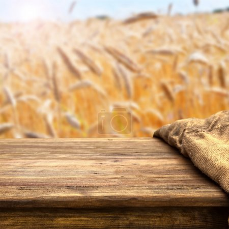 Empty table on wheat field