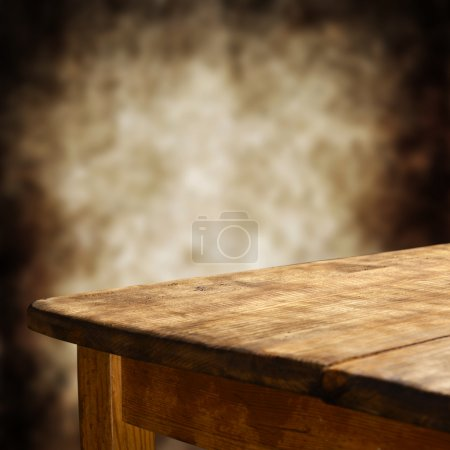 Photo for Empty wooden table for product display montages with blurred background - Royalty Free Image