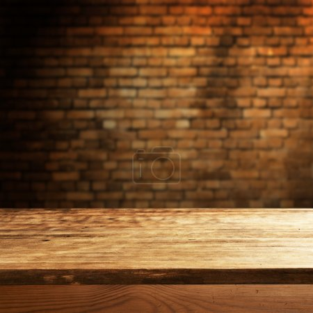 Photo for Empty table for product display montages on brick wall background - Royalty Free Image