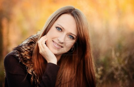 Photo for Autumn portrait of beautiful caucaisan girl outdoors on the nature - Royalty Free Image