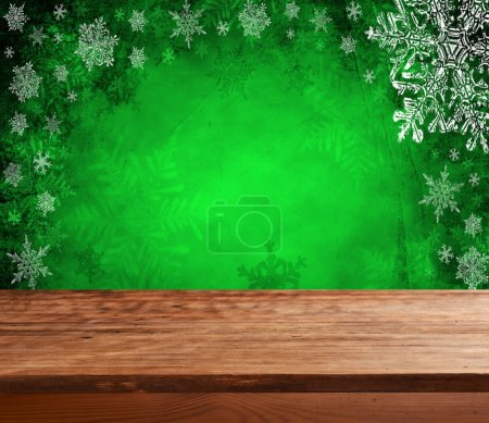Empty  table with green christmas background