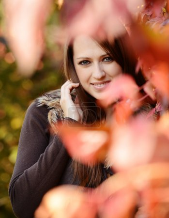 Photo for Portrait of beautiful caucaisan girl among  autumn leaves - Royalty Free Image