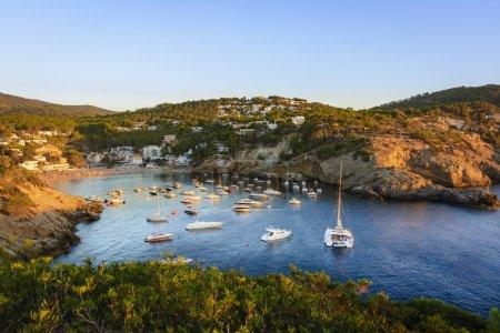 Sunset in the small bay of Cala Vedella, Ibiza island.