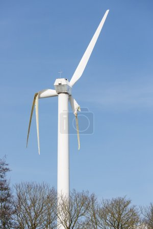 Wind turbine with broken wings after a storm in the Netherlands