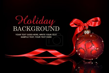 Photo for Elegant Christmas and holiday background with a red ornament and ribbon on a black background - Royalty Free Image