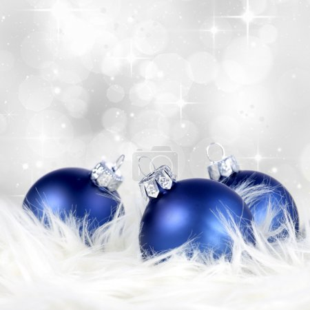 Christmas background with blue silver ornaments on billowy feathers