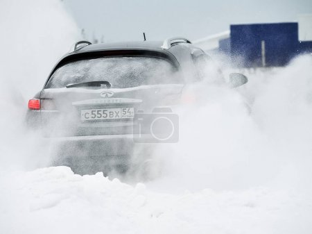 Photo for Moscow, Russia - January 24, 2019: Car infiniti QX70, winter photos of the car when driving through snowdrifts. - Royalty Free Image