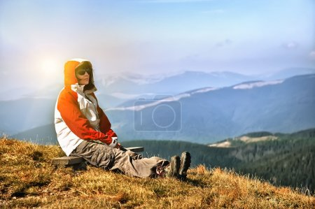 Hiker enjoying valley view from top of a mountain