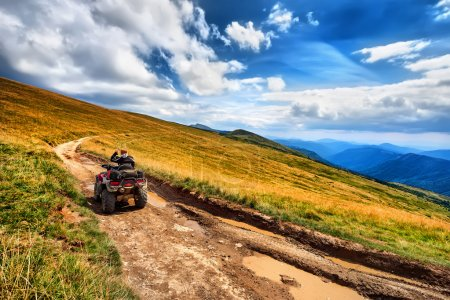 Panorama ATV Quad Bike riders on beautiful mountain landscape ba