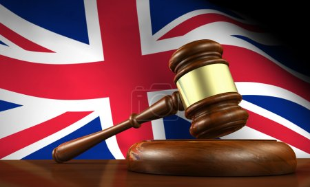 Photo pour Uk law and justice concept with a 3d render of a gavel on a wooden desktop and the Union Jack flag on background. - image libre de droit