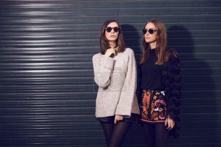 two fashion models posing