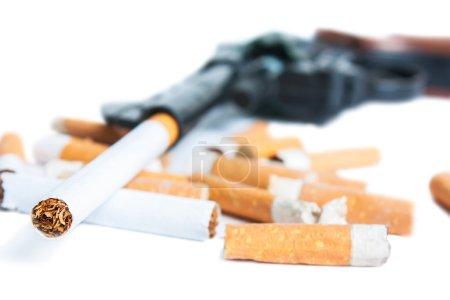 Revolver, cigarettes and cigarette butts isolated ...