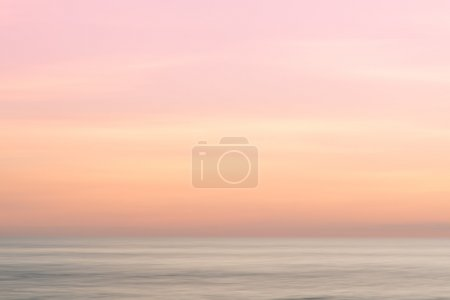 Photo for Abstract sinrise sky and  ocean nature background with blurred panning motion. - Royalty Free Image