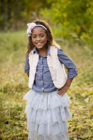 Cute outdoor portrait of a smiling African American little girl