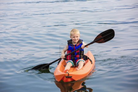 Young Boy paddling a kayak