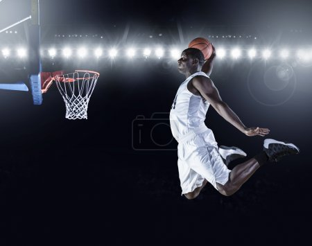 Basketball Player scoring a slam dunk basket.