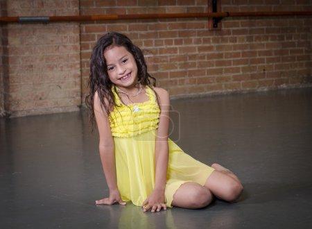 Cute young hispanic dancer in a dance studio