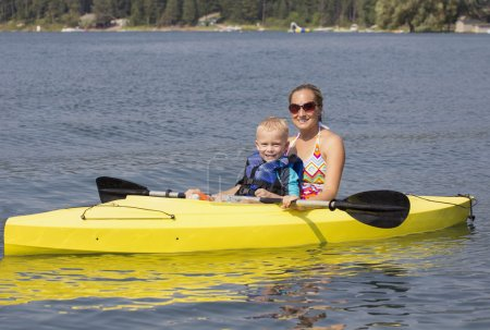 Woman and child Kayaking together