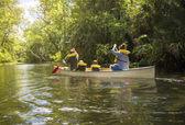 Family  in canoe ride down river
