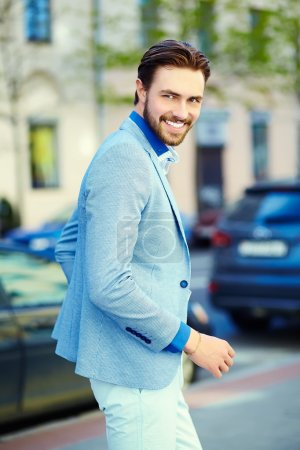 Photo for High fashion look.Young stylish confident happy handsome businessman model  in suit cloth lifestyle in the street in sunglasses - Royalty Free Image