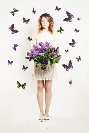 Beauty Girl with Flowers and  Butterfly. Beautiful Model woman w