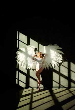 Woman with White Wings on Dark