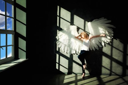 White Angel and Day Light on Black Background
