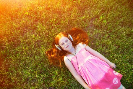 redhead girl with headphones