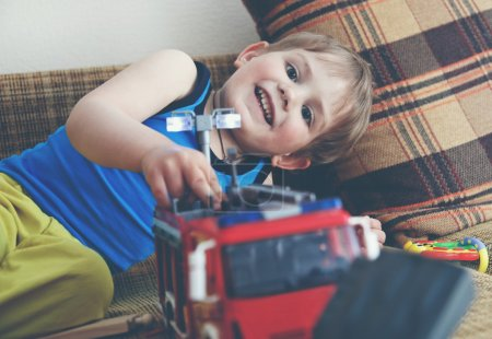 Photo for Cute boy playing with toys - Royalty Free Image