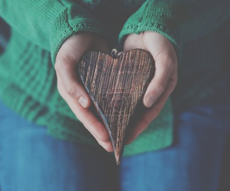 Photo for Hands holding wooden heart - Royalty Free Image