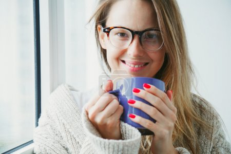 cheerful girl drinking coffee