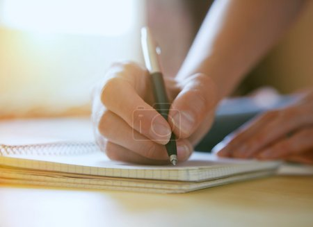 female hands with pen