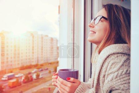 cheerful girl drinking coffee