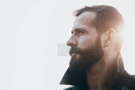 Photo for Portrait of young handsome bearded man in sunlight - Royalty Free Image