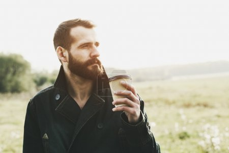 bearded man with paper cup