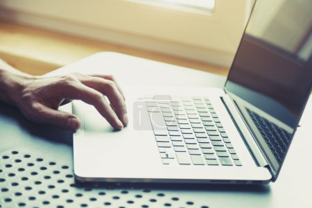 Photo for Male hand working with modern laptop - Royalty Free Image