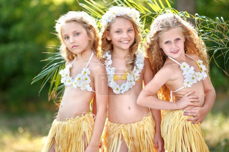 portrait of three girls in a tropical style