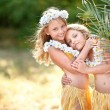 Portrait of two sisters twins in tropical style...