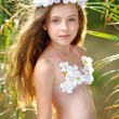 Portrait of little girl in tropical style...