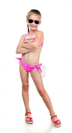 Cute smiling little girl in swimsuit