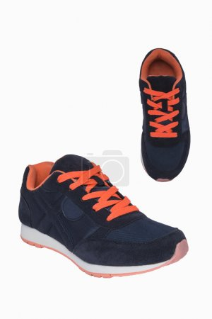 Dark blue sneakers with orange laces