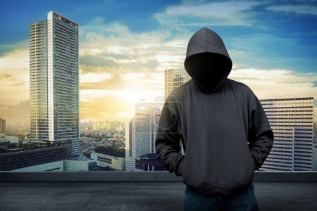Man in hoodie shirt is hacker. Computer security c...