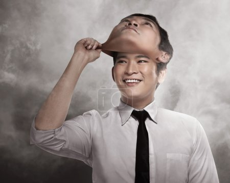 businessman remove his face mask