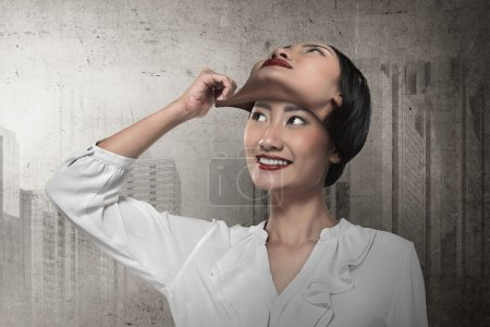businesswoman remove her face mask